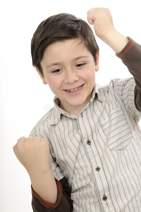 Successful boy gesturing stock photo