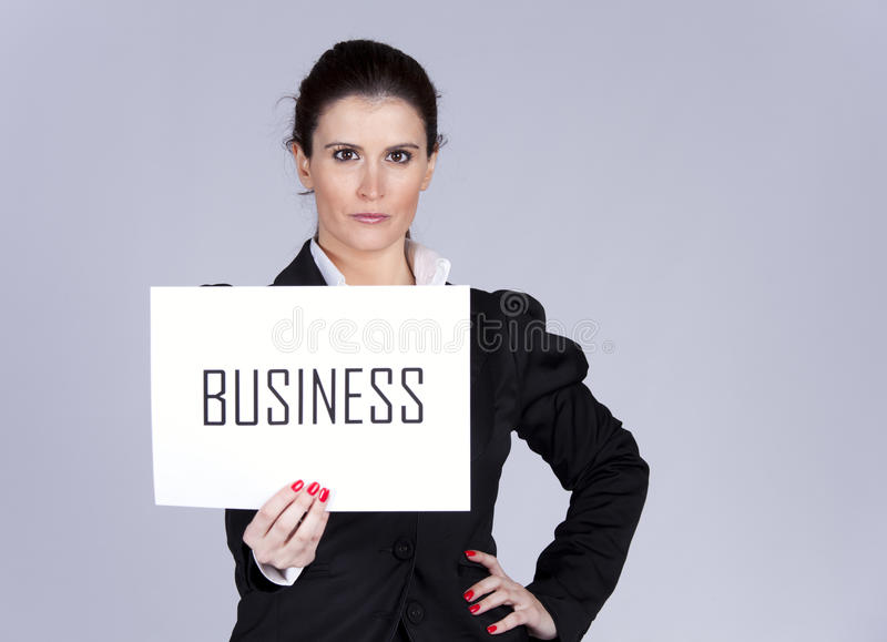 Successful business. Happy businesswoman showing a paper with the word Business stock photos