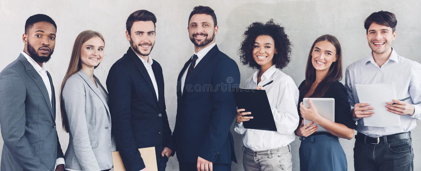 Successful business colleagues looking at camera in office royalty free stock image