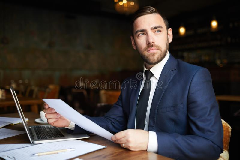 Successful business consultant with papers stock image