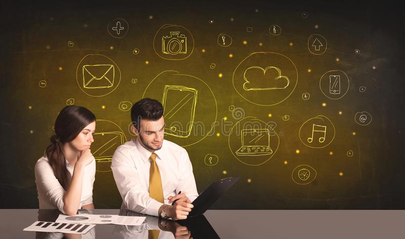 Business couple with media icons background stock images