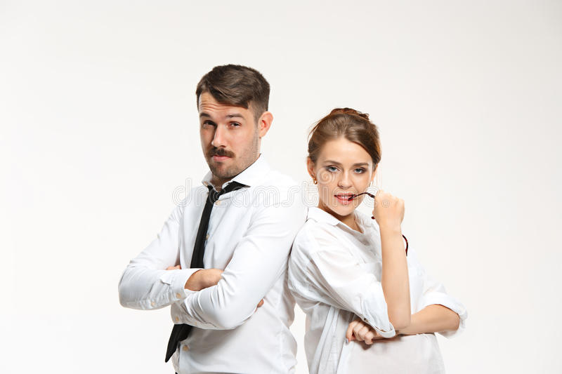 Successful business couple at the office looking at camera. On white background stock photography