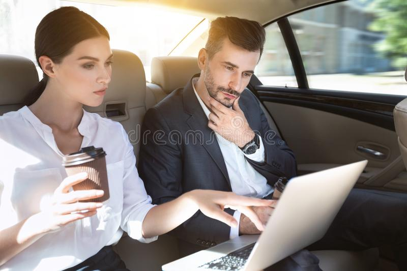 Successful business couple working together in car royalty free stock photo
