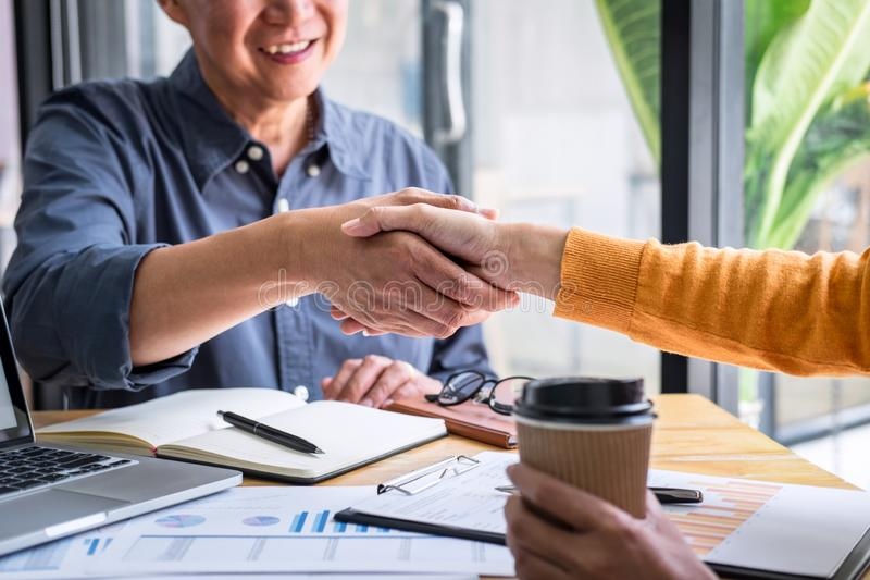 Successful of business deal, Business partnership meeting and handshake after discussing good deal agreement and become a partner. Of trading contract and new stock photography