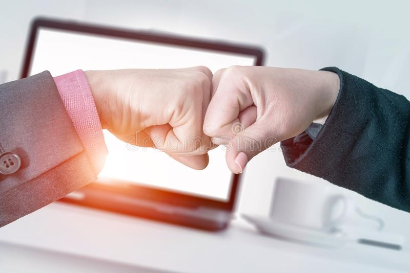 Successful Business Fist Bump. Business Partners Giving Fist Bump in Their Office. Successful Teamwork Hands Gesture Concept. Partnership Business Concept royalty free stock images