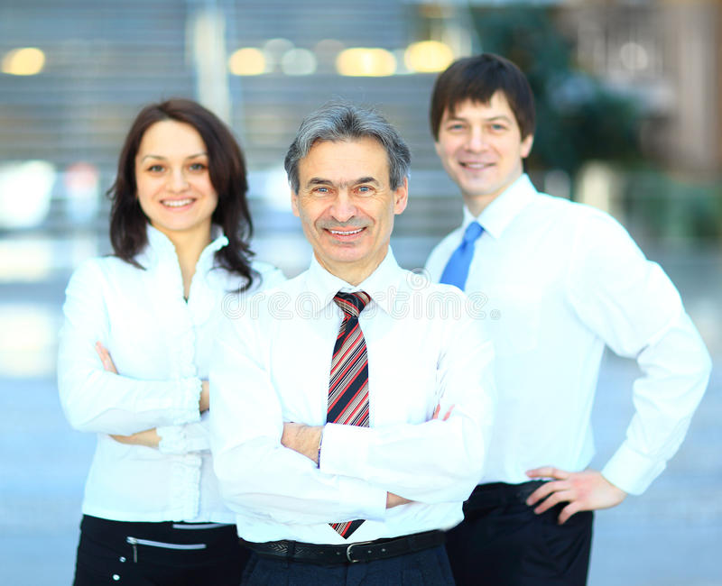 Successful business group. In a row smiling stock photos