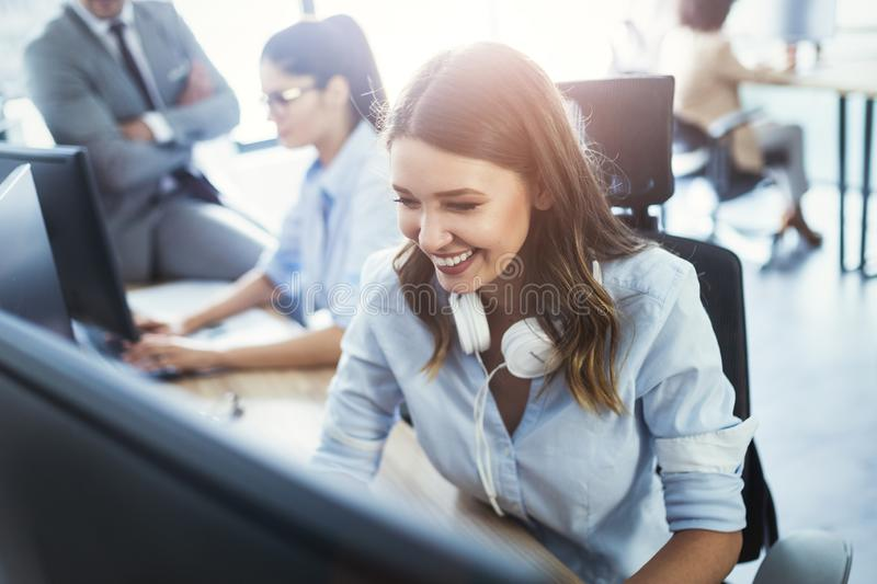 Successful business group of people at work in office stock image