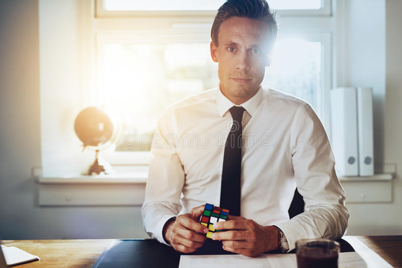 Successful business man solving problems stock photo
