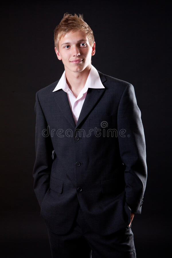 Download Successful Business Man Standing Over Black Royalty Free Stock Images - Image: 20562739