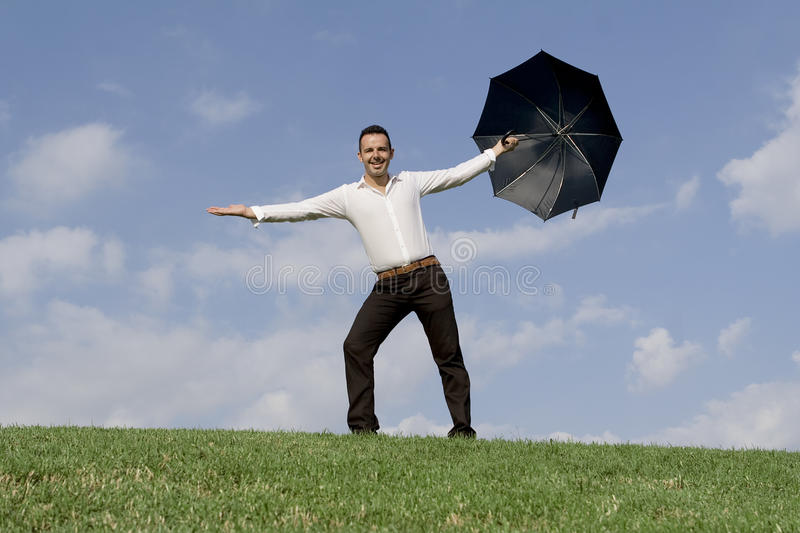 Successful business man with umbrella stock photo