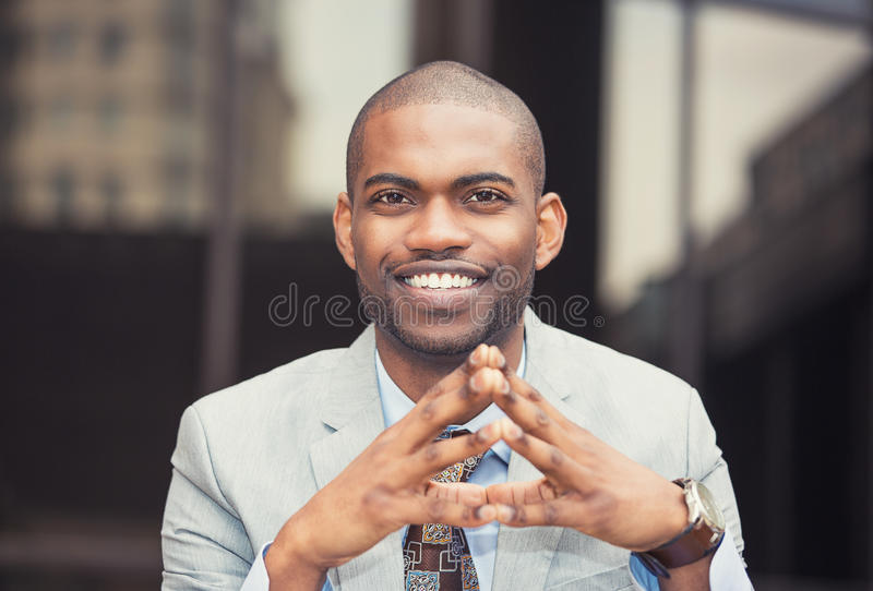 Successful business man. Successful young happy business man sitting outdoors stock photography