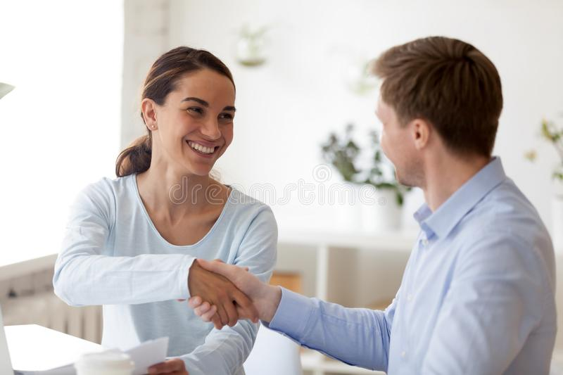 Successful business negotiations with handshake between two partners. Smiling people. Insurance, real estate agent, financial advisor, banker interview with royalty free stock images