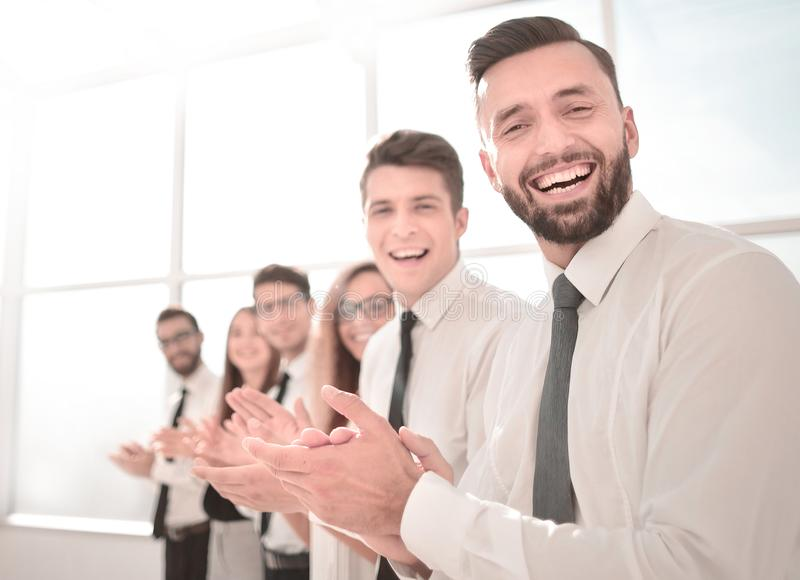 Successful business people applaud standing. Photo with copy space stock photo