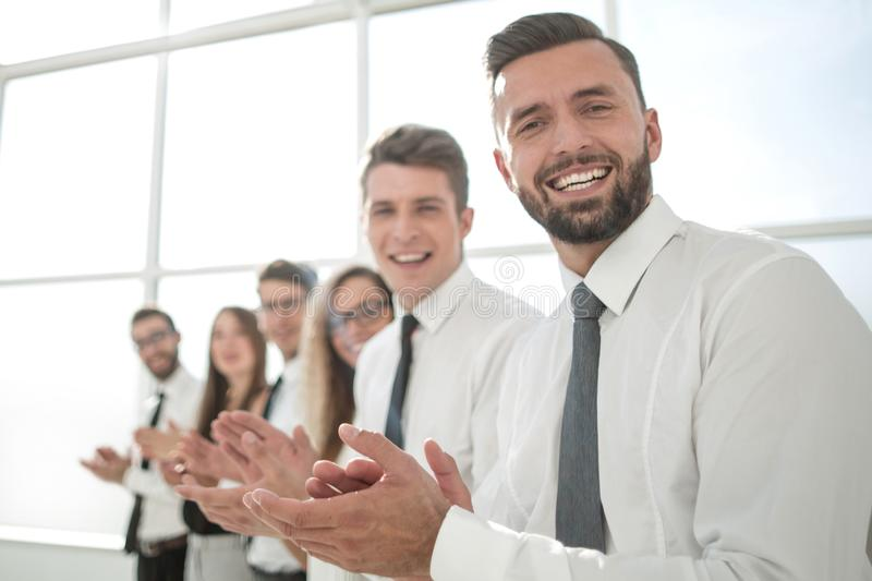 Successful business people applaud standing. Photo with copy space royalty free stock photography
