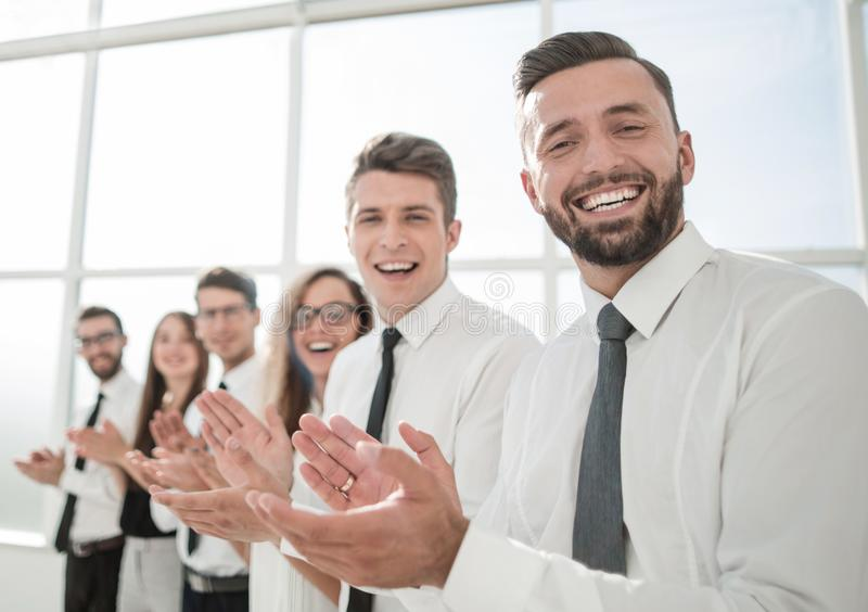 Successful business people applaud standing. Photo with copy space royalty free stock photos