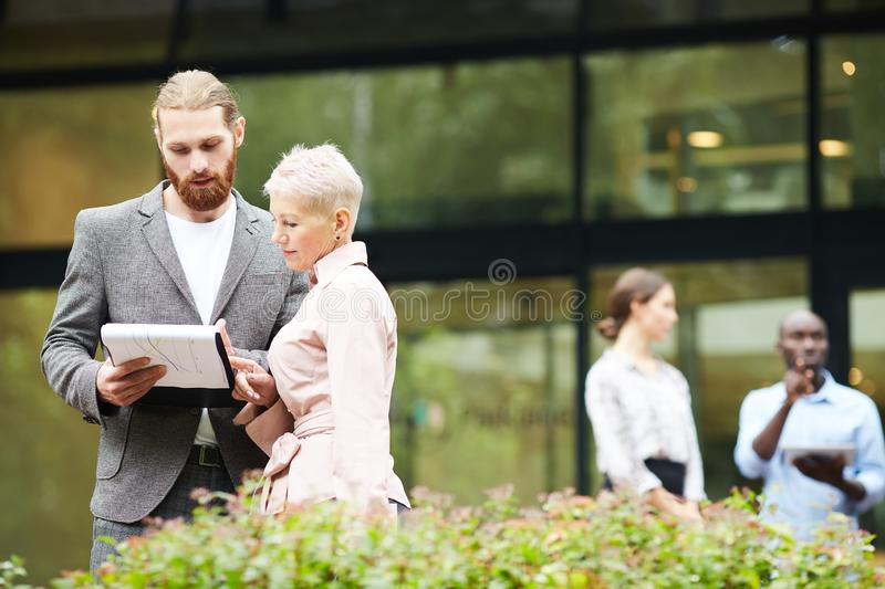 Successful Business People Discussing Work Outdoors royalty free stock images