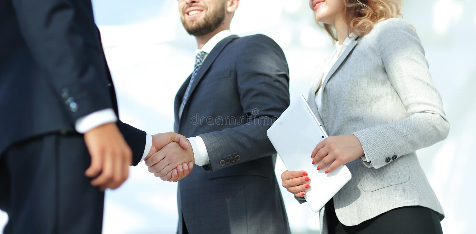 Successful business people handshake greeting deal concept. Close-up shot of businessmen shaking hands in the office stock photos