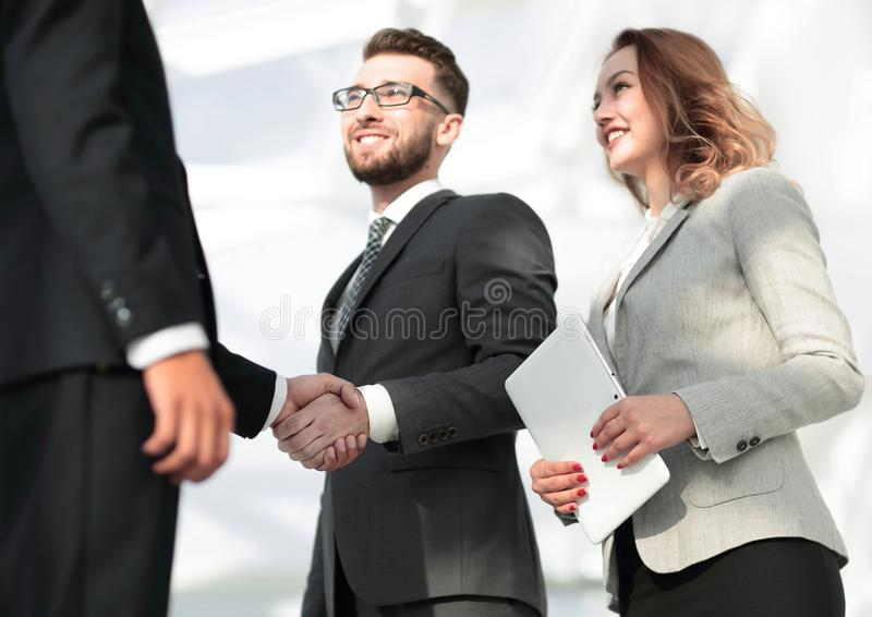 Successful business people handshake greeting deal concept. Close-up shot of businessmen shaking hands in the office stock image