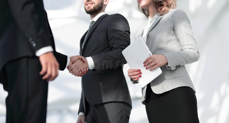 Successful business people handshake greeting deal concept. Close-up shot of businessmen shaking hands in the office royalty free stock photography