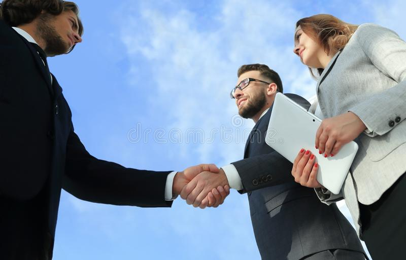 Successful business people handshake greeting deal concept. Close-up shot of businessmen shaking hands in the office royalty free stock image