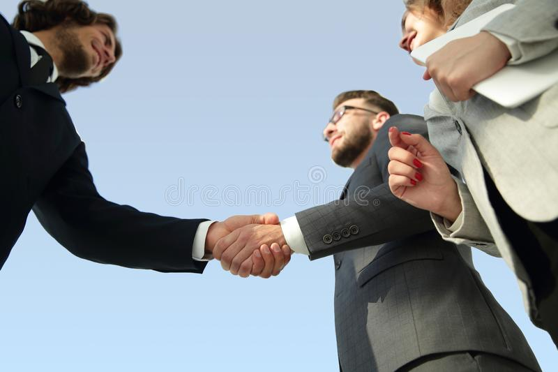 Successful business people handshake greeting deal concept. Close-up shot of businessmen shaking hands in the office royalty free stock photo
