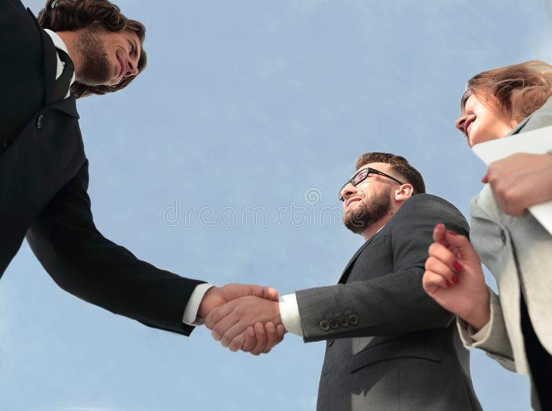 Successful business people handshake greeting deal concept. Close-up shot of businessmen shaking hands in the office stock photo
