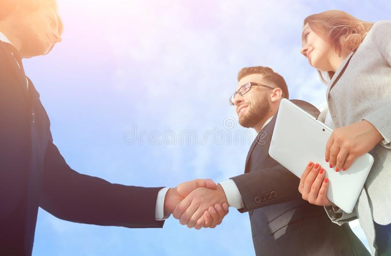 Successful business people handshake greeting deal concept. Close-up shot of businessmen shaking hands in the office royalty free stock photos