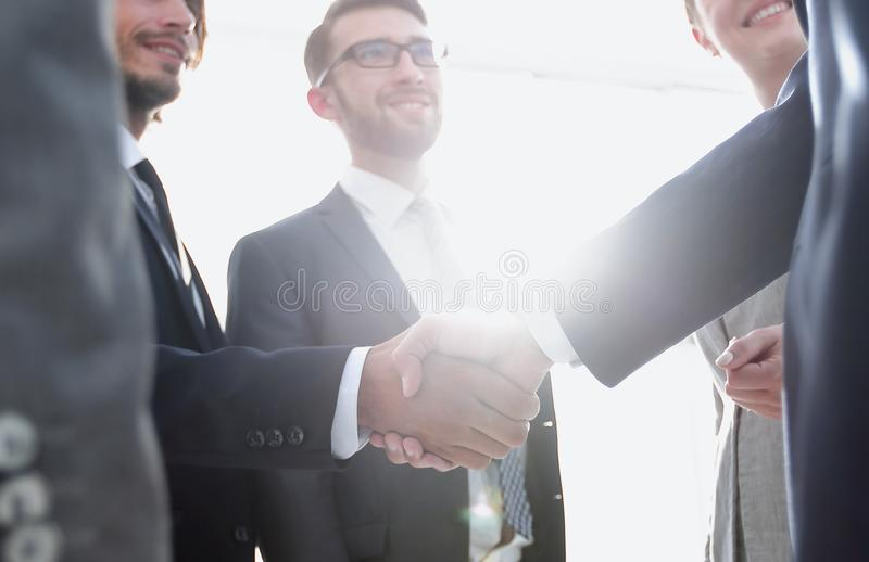 Business people handshaking after good deal. Successful business people handshaking after good deal stock photo