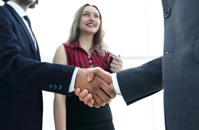 Businessmen handshaking after good deal. Business concept. Successful business people handshaking after good deal royalty free stock images