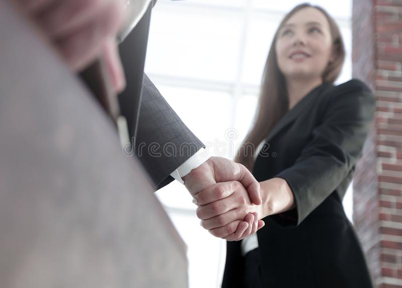 Close up of businessman and businesswoman shaking hands royalty free stock photo