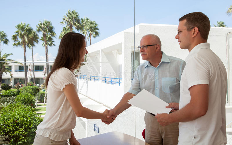Successful business people shaking hands. While making agreement stock image
