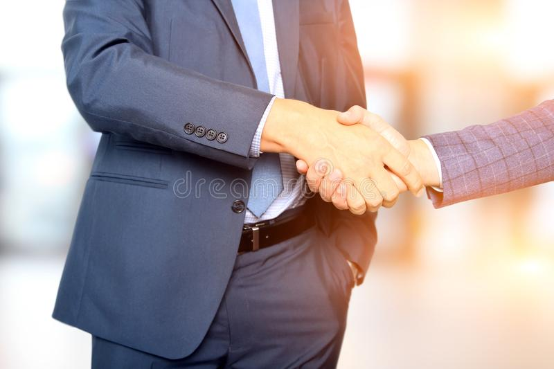 Successful business people shaking hands at the meeting.  royalty free stock images