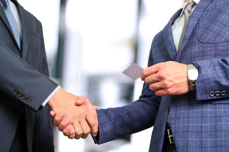 Successful business people shaking hands at the meeting.  stock photos