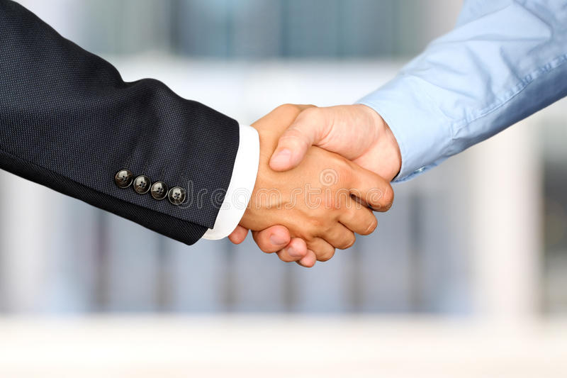 Successful business people shaking hands at the meeting.  royalty free stock photos