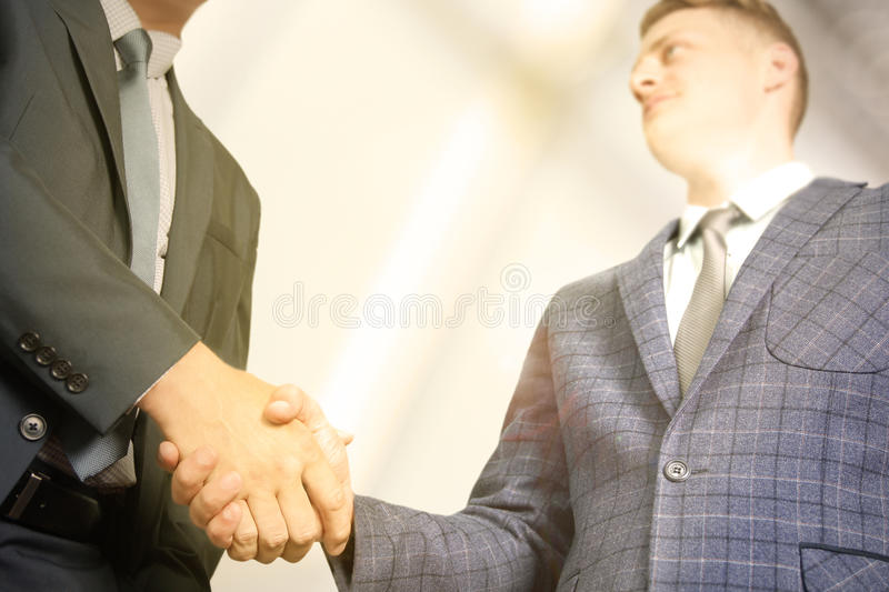 Successful business people shaking hands at the meeting.  stock images