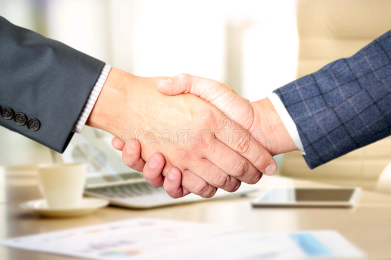 Successful business people shaking hands at the meeting.  stock photography