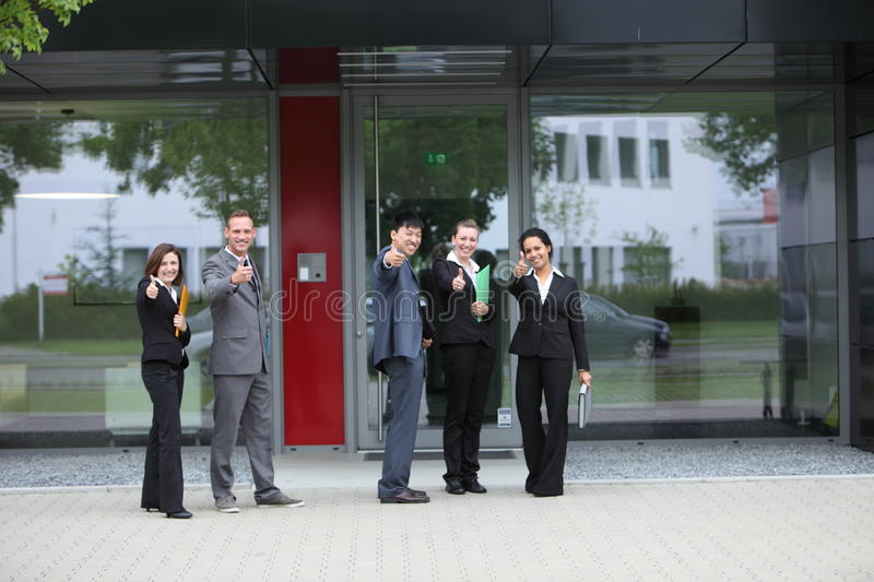 Successful business people showing thumbs up royalty free stock photos