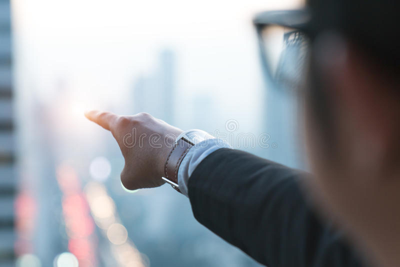 Successful business people standing over city and purposefully stock photography