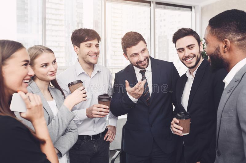 Successful business people talking, having coffee break royalty free stock image