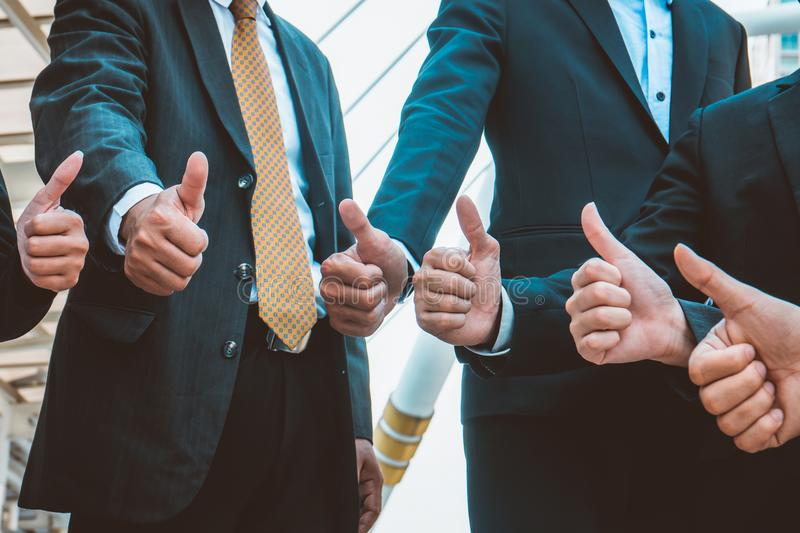 Successful business people with thumbs up and smiling, business stock photography