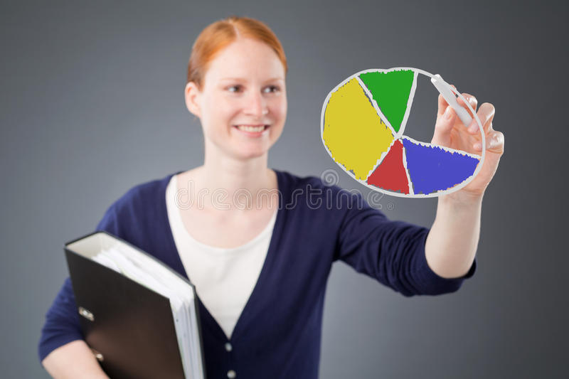 Successful Business Person with Pie Chart royalty free stock photos