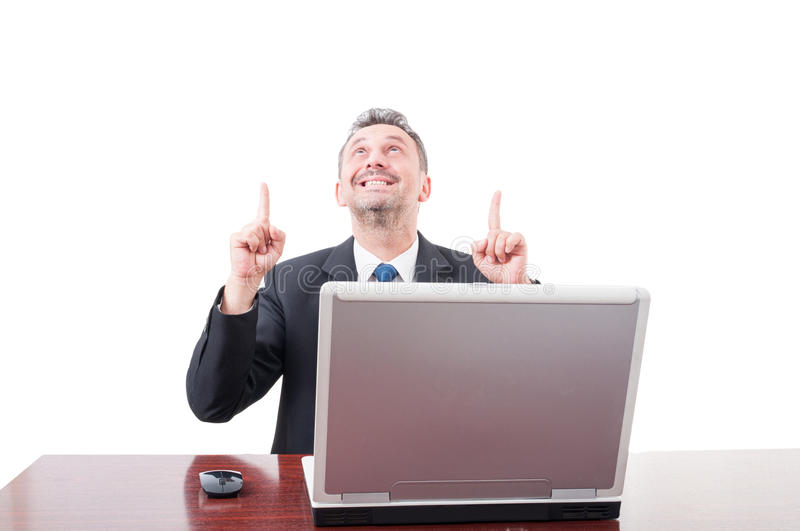 Successful business person pointing both fingers up. Successful business person pointing both fingers and looking up isolatd on white stock image