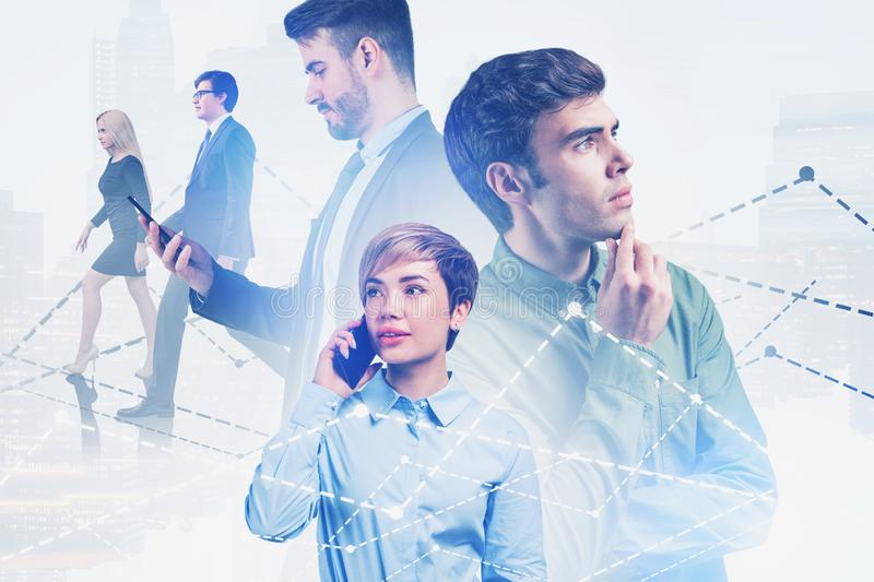 Successful business team in city, trading. Portrait of successful young business people in dark city with double exposure of charts and diagrams. Concept of royalty free stock image