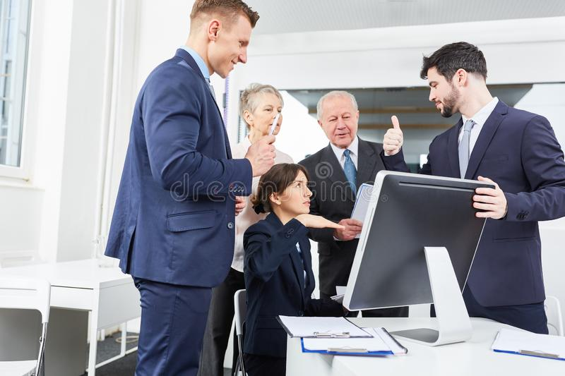 Successful business team with computer royalty free stock image