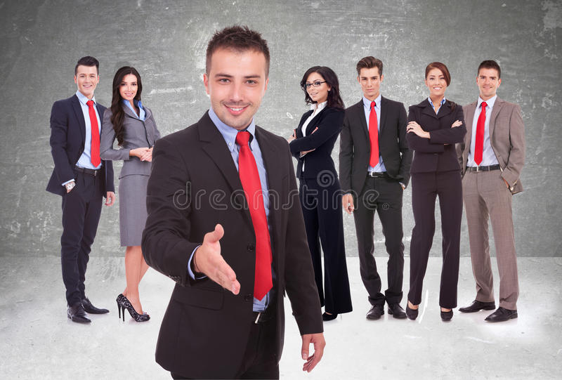 Young business man welcoming to the team royalty free stock photo