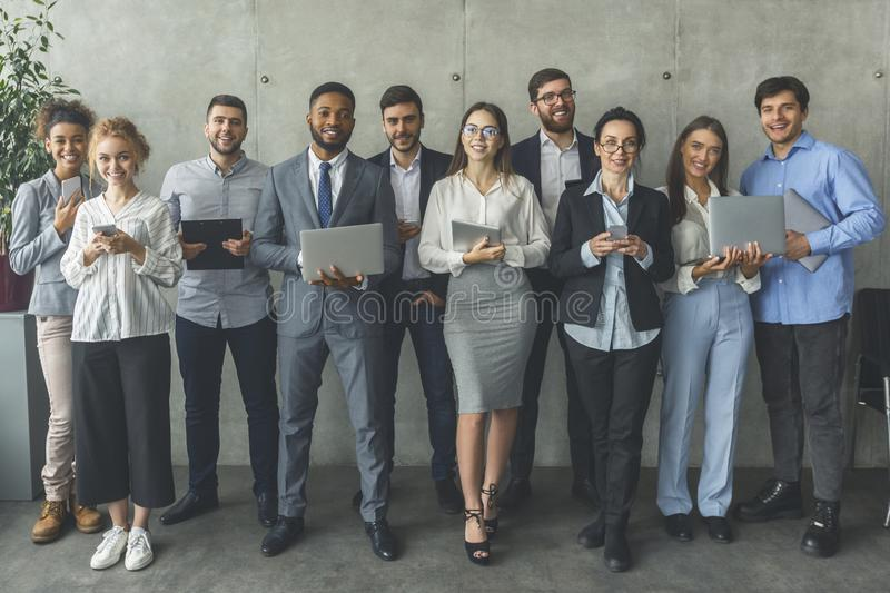 Successful business team. Motivated colleagues smiling to camera stock photos