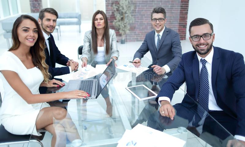 Successful business team sitting at the office Des. K.business concept royalty free stock photo