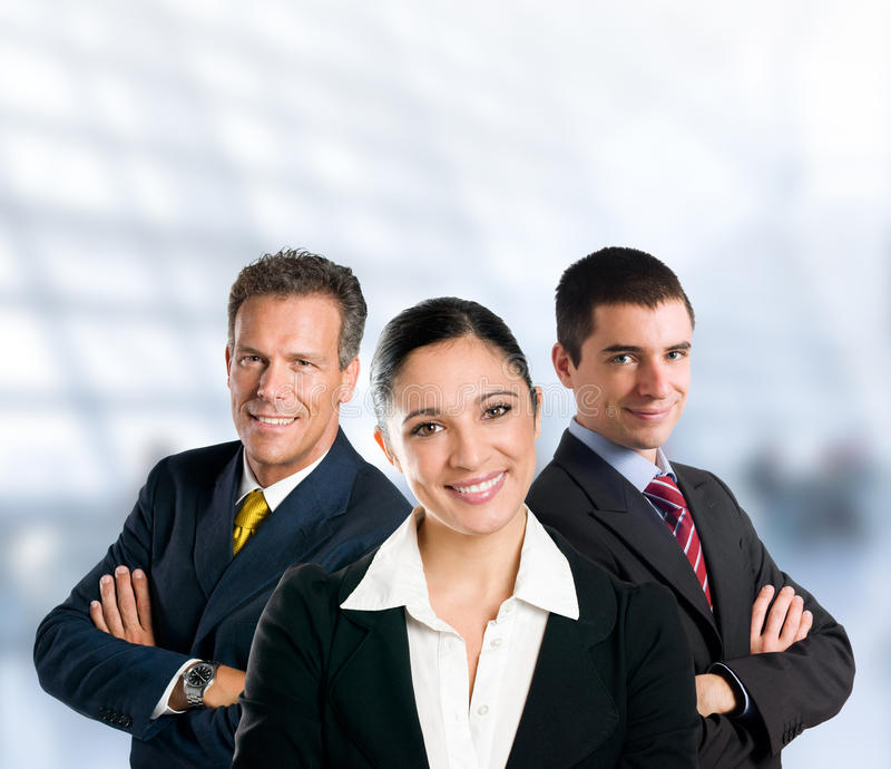 Successful business team smiling in office. Multi aged happy business team with woman and men in a modern office with copy space stock photos
