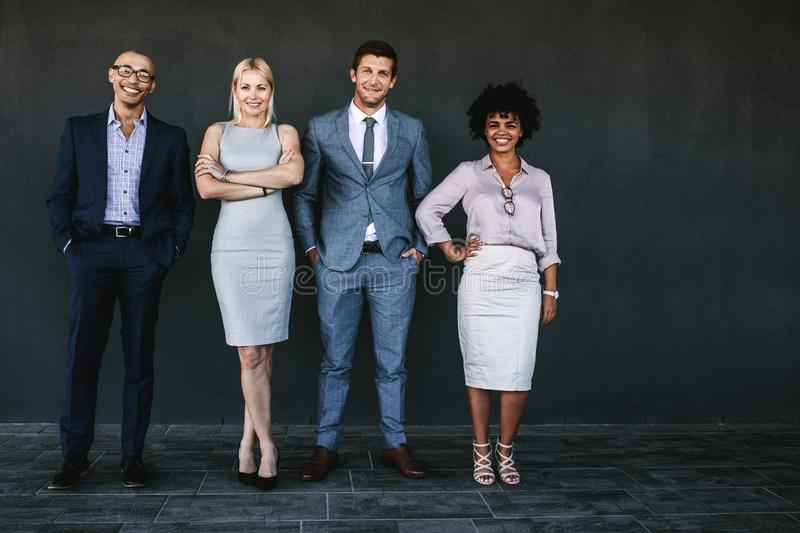 Successful business team standing together and smiling stock photos