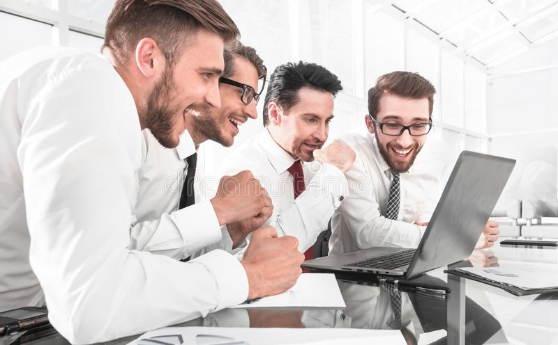 Successful business team using laptop for work stock photography